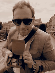 Having a box with Alain Ducasse Chocolates. Enjoying piece by piece on a bridge in Paris!