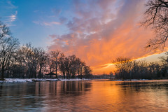 Blue Turns to Orange (tquist24) Tags: elkhart indiana islandpark nikon nikond5300 stjosephriver blue clouds evening geotagged gold longexposure orange park reflection reflections river silhouette sky snow sunset tree trees water winter unitedstates