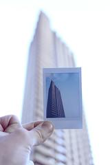 Barbican Juxtposition (Say_No_To_Turtles) Tags: fujifilm instax neo 90 polaroid canon 650d juxtaposed juxtaposition towerblock tower residential flatblock hand