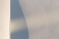 White Shadow (josullivan.59) Tags: wallpaper white 3exp evening texture toronto urban ontario outside artisitic abstract shadow sunsetlight sunset day detail downtown harbourfront light lightanddark canon6d canada clear blue nicelight minimalism 2016 november wall