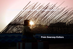 Idol-of-god-with-Bamboo-poles (prem swaroop) Tags: silhouette vizagcityguide vizagbeach travelindia aptourism andhrapradesh sunset pyramid bamboo tourist traveling beach beachroad poles god