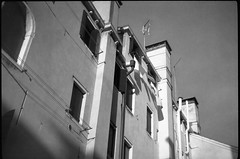 architectural forms and movements, chimneys, clotheslines, Venice, Italy, Bencini Koroll 24S, Fomapan 200, 12.7.16 (steve aimone) Tags: architecture architecturalforms architecturalmovements chimney chimneys clothesline clotheslines geometry venice venezia venetto italy bencinikoroll24s fomapan200 moerschecofilmdeveloper monochrome monochromatic mediumformat blackandwhite 120 120film film