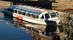 Jeroen Krabbé - Canal Boat Reflections - Amsterdam (Gilli8888) Tags: holland netherlands amsterdam sightseeingboat tourboats canalboats boats waterreflections water jeroenkrabbé windows glass tourism canaltour