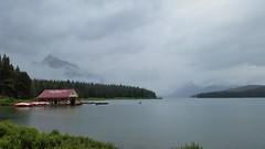 The Boat House at Maligne Lake (Patricia Henschen) Tags: canada alberta parks parcs nationalparks jasper lake clouds malignelake boathouse boats overcast rain canoe