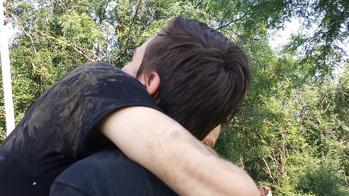 Dirty Chris hugging his clean cousin Andrew.