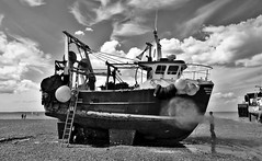 Pressure washing (Aliy) Tags: beach boat kent cleaning beached fishingboat washing pressurewashing whistable hullcleaning