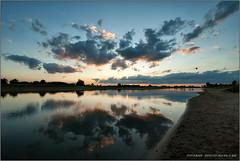 Sunset aan de IJssel [Explored] (Hans van Bockel) Tags: sunset sky water clouds zonsondergang nikon raw nef tripod wolken explore d200 lucht deventer ijssel vanguard spiegeling statief 1024mm altapro