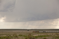 Train and a storm along the Colorado/Oklahoma border (ianseanlivingston) Tags: oklahoma weather train colorado border windmills thunderstorm stormchasing 052415chase plainsscenery