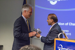 (From left) Former Chamber Board Chair, Plunkett Cooney President and CEO Hank Cooney is presented with a Shinola watch for his outstanding leadership from Chamber President Sandy Baruah.