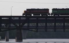 Into Benton County (~nevikk~) Tags: road lights mississippiriver locomotive girders trainbridge freighttrain freightcars bridgegirders bridgesupports supportgirders concretesupports