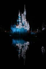 castle from the moat (Turnstiles gone by) Tags: disney disneyworld magic kingdom magickingdom park christmas castle florida light fireworks night nighttime