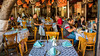2016 - Mexico - Querétaro - 1810 (Ted's photos - For Me & You) Tags: 2016 cropped mexico queretaro santiagodequeretaro tedmcgrath tedsphotos tedsphotosmexico vignetting nikon nikonfx nikond750 restaurant tables tablesetting cafe dining diners seating seated seats sitting chairs napkins glasses wristwatch people onebottle