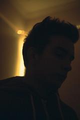 You're Like Gold Dust 9/365 (Elliot Tratt) Tags: portrait portraits boy teen teenage dark bleak hoodie hooded light dust gold golden canon 365 9 2017 people person