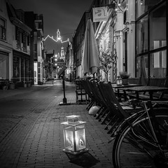 Night Lights (McQuaide Photography) Tags: haarlem noordholland northholland netherlands nederland holland dutch europe sony a7rii ilce7rm2 alpha mirrorless 1635mm sonyzeiss zeiss variotessar fullframe mcquaidephotography lightroom adobe photoshop tripod manfrotto night nacht nightphotography stad city urban lowlight architecture outdoor outside illuminated street straat kleinehoutstraat window wideangle wideanglelens groothoek building longexposure oldstreet old oud character traditional authentic streetlight atmosphere sfeer winter emptystreet deserted empty nopeople cobblestone cobbles shadow light licht shop blackandwhite mono monochrome bw blackwhite square squarecrop 11 lantern restaurant restaurantaangenaam