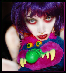My Pet Monster (stOOpidgErL) Tags: portrait selfportrait color me girl face childhood monster female digital self myself toy weird crazy colorful doll purple unique teeth vivid manipulation piercing identity lipring fangs bizarre identitycrisis shocking digitalmanipulation myface mpd lippiercing stoopidgerl mypetmonster multiplepersonalitydisorderproject mulitplepersonalitydisorder