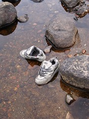 Shoes not required (cyanocorax) Tags: canada abandoned river found shoes rocks quebec object explore laurentides 3waychallenge 3wayshoes explore368