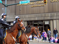 Mounted Policemen (freshasspearmint) Tags: 2005 horses horse building kids uniform cops crowd helmet police richmond parade cop vcu horseback richmondvirginia leatherjacket saddle policeman broadstreet mountedpolice christmasparade policemen policeofficer ukropschristmasparade retailmerchants