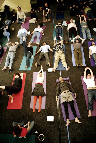Some conference participants in Seattle take a break from sitting with a guided Yoga session. Tomorrows session in City Hall might look very similar. (cc) kk+