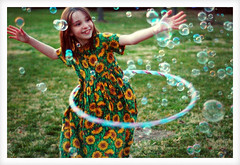 Bubble Dance (FragmentaryBlue) Tags: family people playing color green childhood kids youth d50 children fun toys outdoors interestingness spring nikon bubbles nikond50 nostalgia hulahoop spring06 naturallightkids