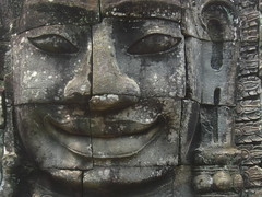 Face at the Bayon temple, Angkor Wat - Cambodia (Sarah Ann Wright) Tags: old sculpture smile face stone mystery mouth nose temple grey carved eyes ancient asia cambodia southeastasia buddhist buddhism ears angkorwat carving puzzle mysterious weathered blocks features jigsaw siemreap angkor facial bayon sculpt weatheredstone bayontemple facialfeatures