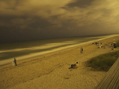 beach at night during lunar eclipse