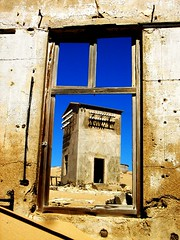 Window to Lost Souls (SqueakyMarmot) Tags: africa travel blue window nature weather catchycolors landscape town sand desert ghost clear ghosttown dust namibia kolmanskop themecinematic lpdry