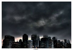Dark City (Arnold Pouteau's) Tags: nyc newyorkcity sunset newyork skyline clouds downtown manhattan gotham hdr