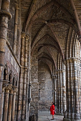 Looking in wonder... (tomgardner) Tags: red woman building history church monument abbey stone architecture religious scotland ancient edinburgh arch palace ceiling holyrood vault awe height