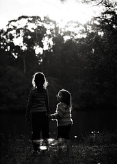 two girls. cousins. friends. ({amanda}) Tags: girls friends light bw evening glow moody 85mm talking bnw sevenyears threeyears amandakeeysphotography