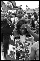 My Special Child (danny.hammontree) Tags: street blackandwhite bw usa art march haiti bush nikon unitedstates florida miami flag georgewbush georgebush politics rally cuba protest d2x photojournalism americanflag 2006 marching april immigrants antibush nikkor cuban amnesty riots immigration activist haitian marches rallies tps hammontree digitalgrace nikond2x 70200mmf28gvr littlehaiti jeanbertrandaristide dannyhammontree wwwdigitalgracecom 20060422 lemoncity temporaryprotectedstatus