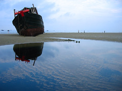The Abandoned Boat (Life in AsiaNZ) Tags: china blue sky abandoned beach tag3 clouds canon landscape boat asia tag2 tag1 searchthebest powershot lookatme     beihai  guangxi     mireasrealm  cmwdblue  lifeinnanning cmwdweeklywinner flickrgiants