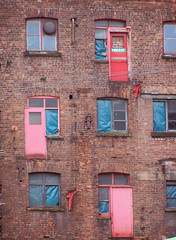 Three Red Doors (Neil101) Tags: door old uk windows red england urban building brick mill window architecture buildings macintosh manchester fire interesting doors factory escape neil warehouse most exit mills derelict wilkinson warehose neilwilkinson neil101 bbcmanchesterblog