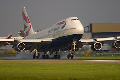 Boeing 747 400 of British Airways landing at London Heathrow. (Greg Bajor) Tags: city uk greatbritain travel sunset red england sky holiday london art lines tarmac night speed plane sunrise out airplane nose lights evening fly flying moving airport wings movement traffic display unitedkingdom britain dusk heathrow aircraft altitude aviation smoke air united jets airplanes touch great transport flight wing jet fast kingdom gear down move off aeroplane landing international journey commercial depart transportation airline planes arrive take commuter fixed british ba boeing arrival airways airports gregory airlines scheme departure baa takeoff runway flights atmospheric 747 airliner lhr airliners aerospace flaps rotate taxiing livery birdlike movingup 436 landings egll runways bajor movingdown aviationart wingslet