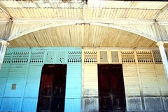 sentral (Farl) Tags: wood travel blue school windows heritage colors yellow architecture facade boards doors arch philippines central cebu bantayan panels portals hardwood capiz preservation fretwork calado stafe cebusugbo bluelist ventanillas