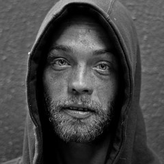 running out of time (stoneth) Tags: poverty sf sanfrancisco california ca street boy portrait people blackandwhite bw white man black male eye face closeup night mouth beard person blackwhite eyes nikon sad homeless jesus poor young photojournalism streetportrait forsakenpeople social impoverished 2006 human hood d200 grayscale nikkor 50mmf18d destitute streetshot nikond200