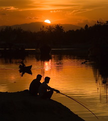Sunset fishing (Kalabird) Tags: travel sunset vacation sun topv111 river boat fishing asia vietnam hoian orangeygoodness ancienttown topvaa skypeople canonef24105mmf4lisusm angkorsingle epapeopleandtheenvironment