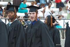Graduates walk in