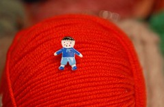 A boy and red merino (sifis) Tags: red colour art wool sweater nikon knitting soft you buttons knit merino athens yarn greece jacket button buy d200 pullover handknitting yarnshop sakalak