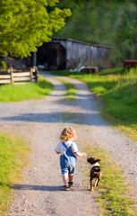 a boy and his dog (-Angela) Tags: summer dog walking topf50 westvirginia frombehind theson 50100fav tc86kidsbestfriends