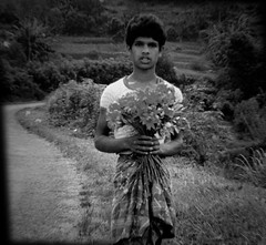 flower boy (Norma Desmond) Tags: portrait bw photoshop srilanka flowerboy holgaplay childrenofsrilankabw