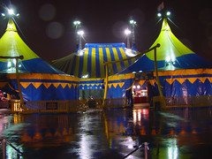 Dralion's Concession tents & Big Top on a rainy night (Pat Rioux) Tags: blue newyork yellow site jerseycity circus tent infrastructure masts cirque cirquedusoleil bigtop dralion grandchapiteau
