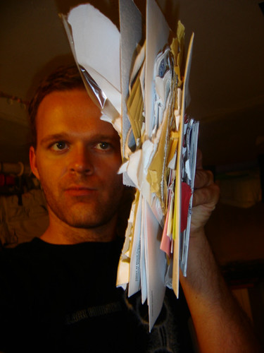 a man with a pile of student loan statements