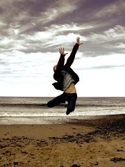 Grab a cloud (Earlette) Tags: beach kids children fun jumping 2006 reach