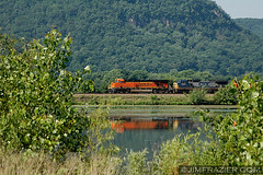BNSF 7644 and CSX 7833 at Trempealeau National Wildlife Refuge (Jim Frazier) Tags: road trip railroad travel summer vacation lake industry nature water june metal wisconsin rural forest train woodland landscape countryside pond woods scenery commerce diesel country tracks engine machine engineering rail railway trains roadtrip 2006 heavymetal equipment business machinery engines locomotive marsh bluffs heavy preserve freight bnsf naturepreserve smalltown q3 apparatus bluff locomotives usfws railroads refuge nationalwildliferefuge csx fws freighttrain nwr trempealeau v500 7644 trempealeaunationalwildliferefuge 7833 trempeauleaunwr jun2006trempeauleaunwr trempealeautrains jimfraziercom
