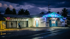 South Pacific Night (Laith Stevens Photography) Tags: night handheld lights shop south pacific general store clouds outdoors palm trees man reflections vivid olympus omd em1 1240mm f28 pro zuiko graffiti goneawol olympusinspired