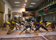 The Traditional Sport Of Zurkhaneh, Isfahan Province, Kashan, Iran (Eric Lafforgue) Tags: people men sport horizontal training photography persian wooden athletic asia exercise iran wrestling muslim islam traditional performance ceremony middleeast competition persia bodybuilding indoors clubs ritual wrestler strength tradition activity orient groupofpeople kashan sufi sufism cultures islamic kachan zurkhaneh shiite practising menonly meel exercising traditionalsport إيران onlymen иран 5people colourimage イラン zourkhaneh irão isfahanprovince strengthtraining 伊朗 zurkhane muscularbuild sportstraining houseofstrength 이란 iran150655