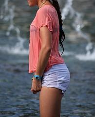 squeeze (TazNoMore) Tags: summer playing cute wet water fountain girl kids fun profile tshirt teen ponytail pocahontas shortshorts