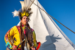 Milk River Indian (www.toddklassy.com) Tags: travel blue shadow portrait sky sunlight heritage history yellow horizontal proud standing pose montana colorful mt dress harlem indian traditional feathers ceremony culture posing lifestyle sunny competition pride dancer tent clothes nativeamerican portraiture warrior copyspace teepee plains tribe spiritual multicolored ethnic celebrate cultural assiniboine indigenous headdress regalia powwow tepee brightlycolored colorimage grosventre environmentalportraiture nakota blainecounty tipt fortbelknapindianreservation aaniiih