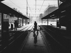 hazy shade of winter (matthias hämmerly) Tags: zürich zuerich street streetphotography snow cold winter tram public transport station shadow man contrast grain ricoh grd2 candid wow brilliant