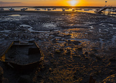 Stranded at sunset (ORIONSM) Tags: boat sunset stranded lowtide water sea coast faro olympus omdem10markii